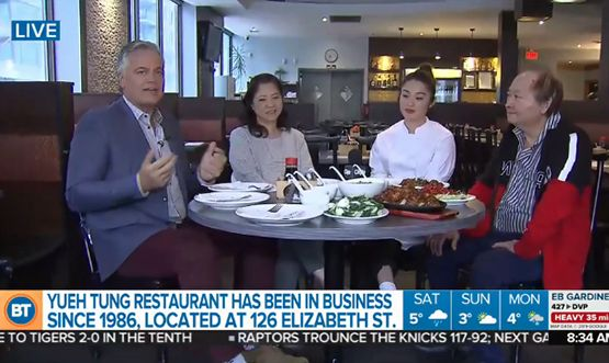 A screen shot of Breakfast Television of a man interviewing three people